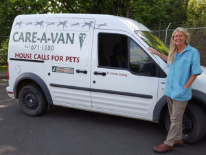 Christy standing by the CARE-A-Van van